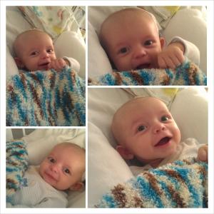 Asher smiles