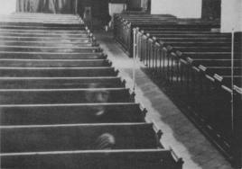 Ghost sitting in church pew