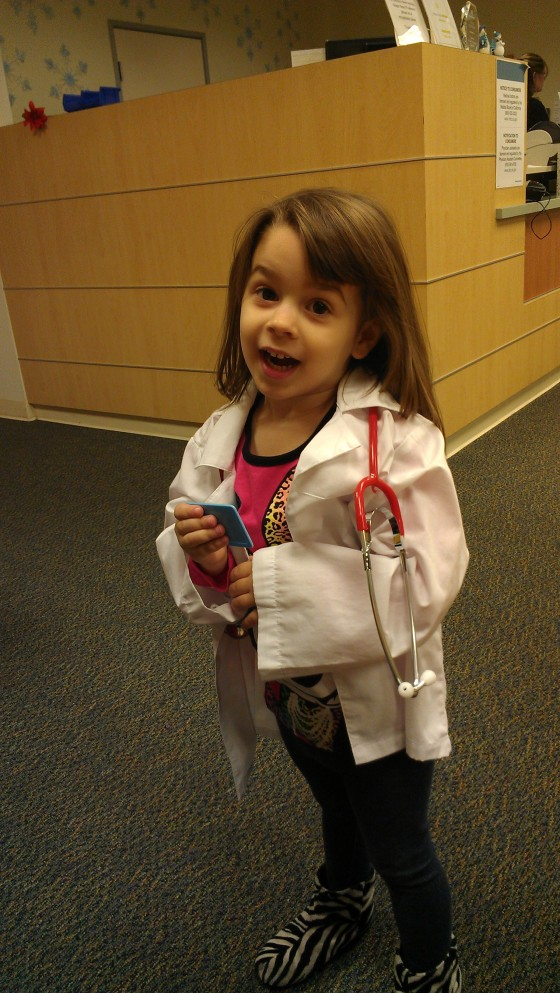 Daughter in doctors coat